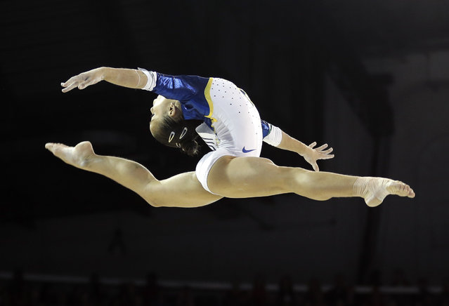 Brazil's Flavia Lopes performs on the balance beam during women's artistic gymnastics team competition in the Pan Am Games in Toronto, Sunday, July 12, 2015. (Photo by Gregory Bull/AP Photo)
