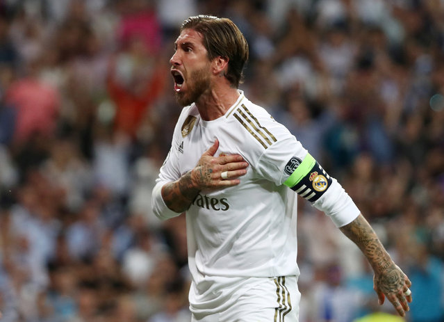 Real Madrid's Spanish defender Sergio Ramos reacts after scoring during the UEFA Champions league Group A football match between Real Madrid and Club Brugge at the Santiago Bernabeu stadium in Madrid on October 1, 2019. (Photo by Jon Nazca/Reuters)