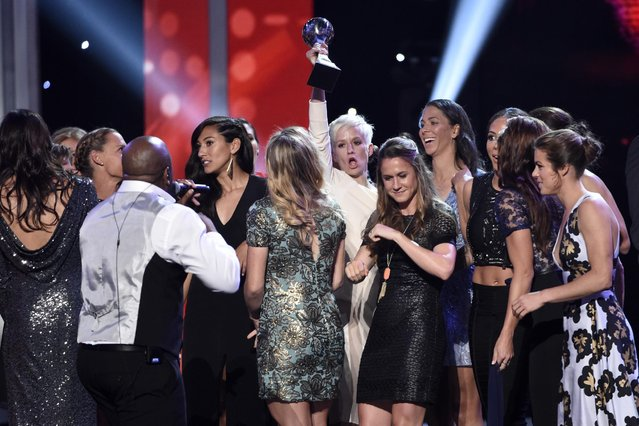 Members of the U.S. women's national soccer team celebrate on stage after accepting the best team award at the ESPY Awards at the Microsoft Theater on Wednesday, July 15, 2015, in Los Angeles. (Photo by Chris Pizzello/Invision/AP Photo)