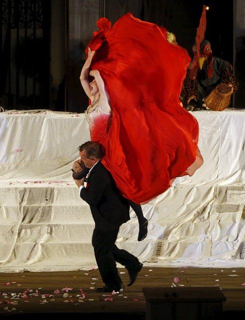 "Actor Cornelius Obonya as Jedermann and actress Brigitte Hobmeier as Buhlschaft perform on stage during a dress rehearsal of Hugo von Hofmannsthal's drama ""Jedermann"" (Everyman) at Domplatz square in Salzburg, Austria, July 16, 2015. (Photo by Leonhard Foeger/Reuters)"