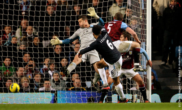 Joleon Lescott of Manchester City scores the opening goal past Shay Given of Aston Villa during the Barclays Premier League match between Aston Villa and Manchester City at Villa Park