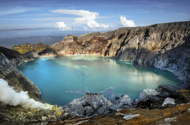 """The world's largest highly acidic lake"". On the west of Mount Merapi, is the 1km wide turquoise colored acid crater lake called Kawah Ijen. It is the world's largest highly acidic lake (pH<0.5) and it lies inside a larger caldera of the Ijen Volcanoes. Photo location: Kawah Ijen, Mount Merapi, East Java, Indonesia. (Photo and caption by Khandakar Usayed/National Geographic Photo Contest)"