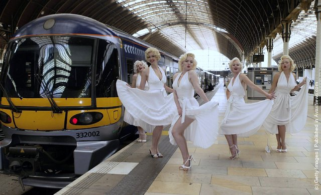 Five Marilyn Monroe look-alikes participate in the Heathrow Express Fifth birthday celebrations at Paddington Station on June 23, 2003 in London