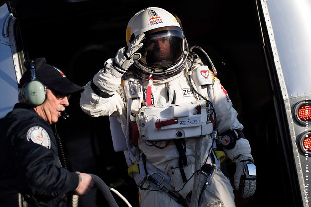 Pilot Felix Baumgartner of Austria seen on his way to the capsule during the first manned test flight for Red Bull Stratos