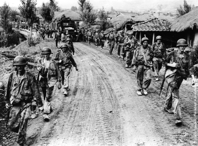 Battle-weary American troops withdraw from Yong San in Korea, 1950