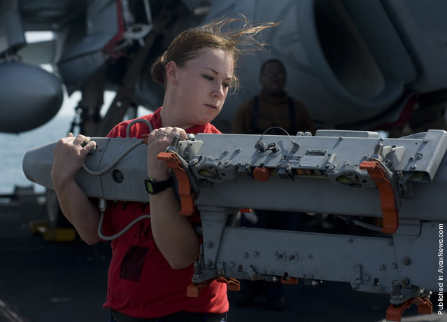 Aviation Ordnanceman 3rd Class Alecia Crockett, assigned to the Kestrels of Strike Fighter Squadron (VFA) 137, moves a BRU-41 multiple ejector rack on the flight deck of the Nimitz-class aircraft carrier USS Abraham Lincoln (CVN 72)