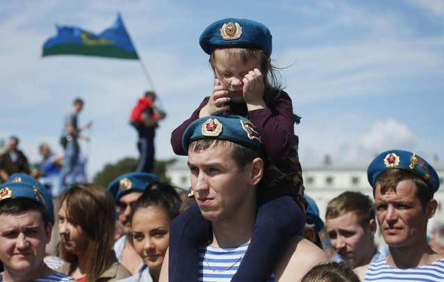 Former paratroopers celebrate Paratroopers' Day in St.Petersburg, Russia, Sunday, August 2, 2015. (Photo by Dmitry Lovetsky/AP Photo)