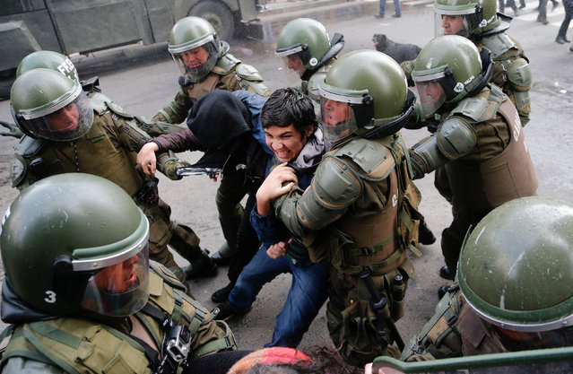 A demonstrator is detained by riot police during a protest against government education reforms in Valparaiso city, Chile, June 9, 2016. (Photo by Rodrigo Garrido/Reuters)