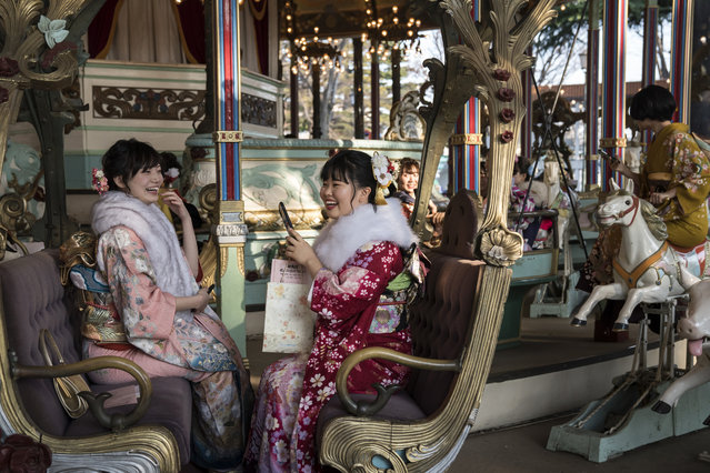 Women wearing kimonos ride a merry-go-round after attending a Coming of Age ceremony at the Toshimaen amusement park on January 13, 2020 in Tokyo, Japan. (Photo by Tomohiro Ohsumi/Getty Images)