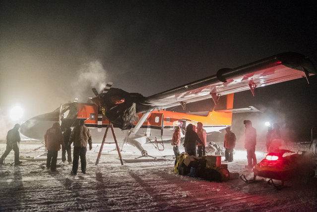 A small plane picks up a sick worker at the U.S. South Pole science station on June 22, 2016. Once the sick patient and the crew rest, they will then fly off Antarctica for medical attention that could not be provided on the remote continent. (Photo by Robert Schwarz/NSF via AP Photo)