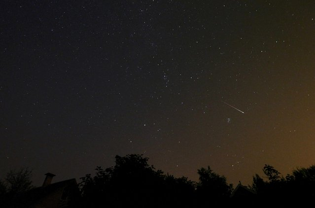 A meteor streaks across the sky during the Perseid meteor shower near the village of Goroshki, west of Minsk, Belarus, in the early morning August 12, 2015. The annual Perseid meteor shower reaches its peak on August 12 and 13 in Europe, according to NASA. (Photo by Vasily Fedosenko/Reuters)