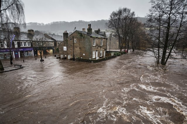 Shortlisted: Steve Morgan. On Boxing day 2015, floods came to Hebden Bridge, a thriving ex-mill town in the Calder Valley, West Yorkshire. Flood sirens echoed around the Valley at 7.30am, alerting sleeping residents to the rising waters about to engulf the town. (Photo by Steve Morgan/2016 EPOTY)