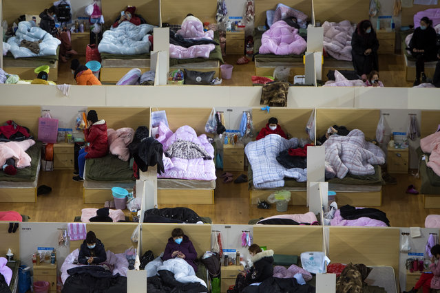 In this Monday, February 17, 2020, photo released by Xinhua News Agency, patients infected with the coronavirus take rest at a temporary hospital converted from Wuhan Sports Center in Wuhan in central China's Hubei Province. China reported thousands new virus cases and more deaths in its update Tuesday on a disease outbreak that has caused milder illness in most people, an assessment that promoted guarded optimism from global health authorities. (Photo by Xiao Yijiu/Xinhua via AP Photo)
