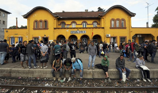 A group of immigrants who have made through police blockades arrive at the Gevgelija railway station August 21, 2015. (Photo by Ognen Teofilovski/Reuters)