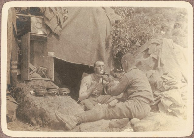 Q.M. Maloney shaving, (as another soldier holds up a mirror for him, June? 1915)