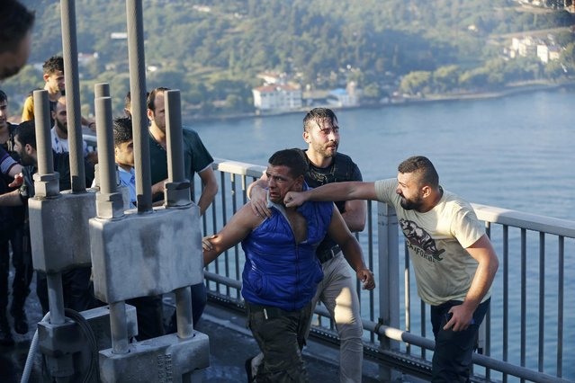 A civilian beats a soldier after troops involved in the coup surrendered on the Bosphorus Bridge in Istanbul, Turkey July 16, 2016. (Photo by Murad Sezer/Reuters)