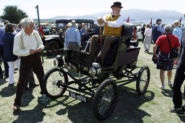 An entrant sits in his 1902 Toledo Model A Stanhope Ranabout during the Concours d'Elegance at the Pebble Beach Golf Links in Pebble Beach, California, August 17, 2014. (Photo by Michael Fiala/Reuters)