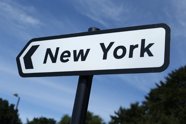A road sign poinst the way on August 7, 2013 in New York, England. The original reason for the name of New York is not known, but it is thought that it may be connected to the once dominant coal mining industry in the area. (Photo by Peter Macdiarmid/Getty Images)