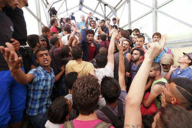 Migrants gather at the railway station in the town of Bicske, Hungary, September 3, 2015. (Photo by Laszlo Balogh/Reuters)