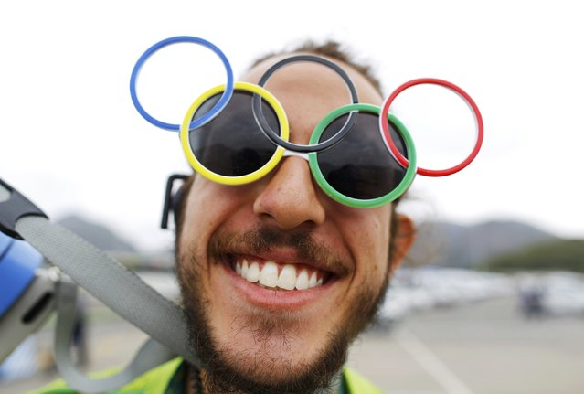 2016 Rio Olympics, Olympic Park on July 29, 2016. A volunteer wears novelty spectacles outside the Olympic Park. (Photo by Ivan Alvarado/Reuters)