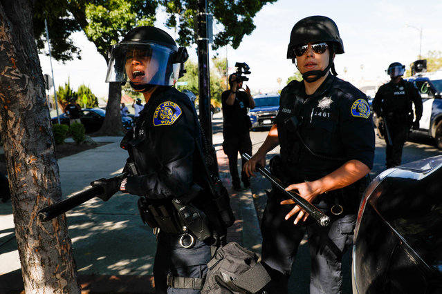 Police try to push protesters back on East Santa Clara Street during a protest decrying the police killing of George Floyd in downtown San Jose on Friday, May 29, 2020. (Photo by Randy Vazquez/Bay Area News Group)