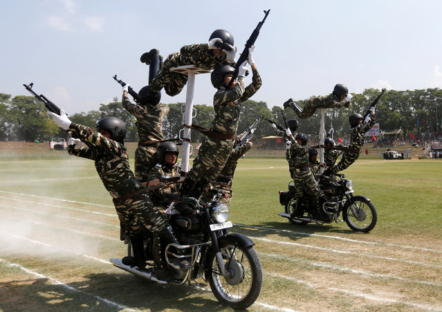 Indian policewomen perform a stunt on their motorbikes during the full-dress rehearsal ahead of India's Independence Day celebrations in Srinagar, August 13, 2016. (Photo by Danish Ismail/Reuters)