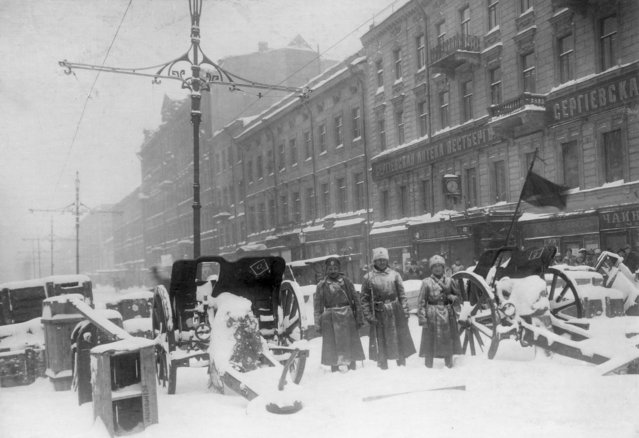 In this photo taken in February 1917, provided by Russian State Archive of Social and Political History, soldiers stand at the barricade in Liteyny Avenue in St.Petersburg, Russia. The 1917 Bolshevik Revolution was long before the digital revolution allowed anyone to instantly document events. But the clumsy cameras of the time still caught some images that capture the period's drama. (Photo by Yakov Steinberg/Russian State Archive of Social and Political History via AP Photo)