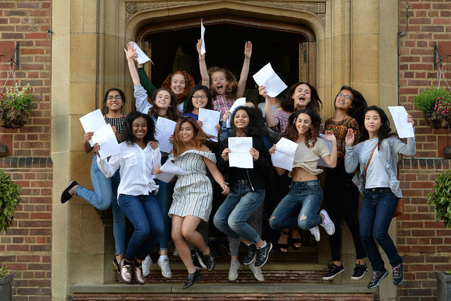 Students celebrate their A-level results at King Edward VI High School for Girls in Birmingham, England on August 18, 2016. The proportion of top grades achieved by A-level students across the UK has fallen for a fifth year in a row, and girls have caught up with boys in attaining A* grades. (Photo by Joe Giddens/PA Wire)