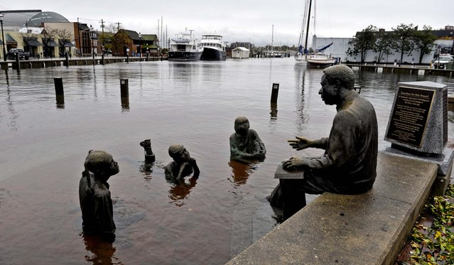 The Kunta Kinte-Alex Haley Memorial sits in flood waters in downtown Annapolis, Maryland. (Photo by Susan Walsh/Associated Press)