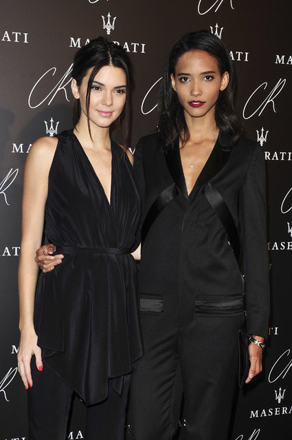 Kendall Jenner, left, and an unidentified friend attend the launch party of the CR Fashion Book N.5 hosted by Carine Roitfeld & Stephen Gan in Paris, Tuesday, September 30, 2014. (Photo by Zacharie Scheurer/AP Photo)