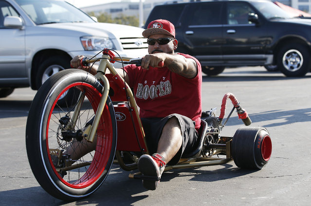 A man rides his motorized tricycle in the parking lot of Levi's Stadium before the start of an NFL preseason football game between the San Francisco 49ers and the Green Bay Packers Friday, August 26, 2016, in Santa Clara, Calif. (Photo by Tony Avelar/AP Photo)