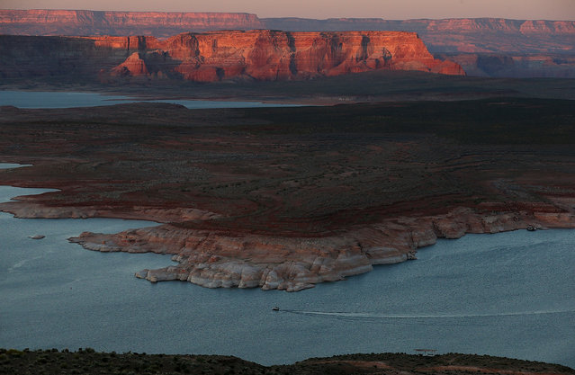 A boat navigates the waters of Lake Powell on March 28, 2015 in Page, Arizona.  As severe drought grips parts of the Western United States, a below average flow of water is expected to enter Lake Powell and Lake Mead, the two biggest reservoirs of the Colorado River Basin. Lake Powell is currently at 45 percent of capacity and is at risk of seeing its surface elevation fall below 1,075 feet above sea level by September, which would be the lowest level on record. The Colorado River Basin supplies water to 40 million people in seven western states. (Photo by Justin Sullivan/Getty Images)
