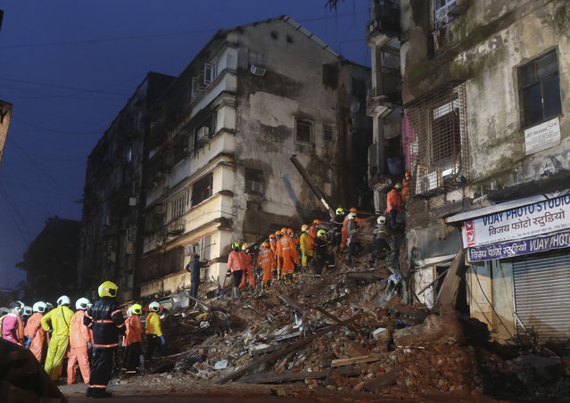Rescuers work at the site after a six-storey residential building collapsed in Mumbai, India, Thursday, July 16, 2020. (Photo by Rafiq Maqbool/AP Photo)