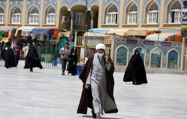 People visit the Fatima Masumeh Shrine, which is less crowded than usual due to coronavirus (Covid-19) pandemic, in Qom, Iran on June 15, 2020. People in Iran's Qom, where Covid-19 cases and the first deaths from the epidemic occurred in the country, continue to stay at home even though government has lifted coronavirus restrictions. (Photo by Fatemeh Bahrami/Anadolu Agency via Getty Images)