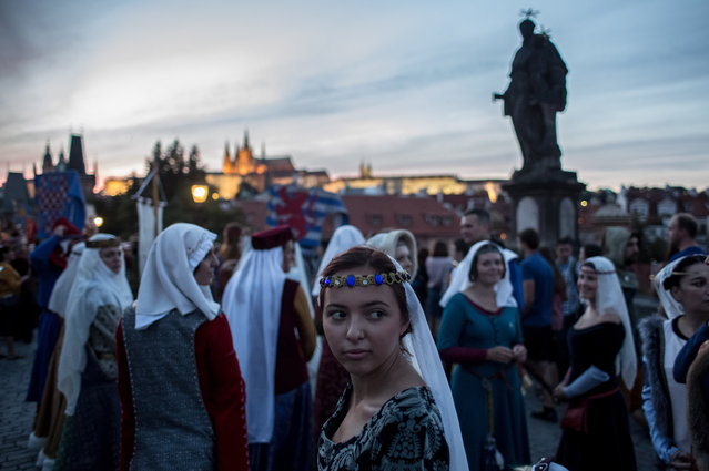 "People wearing medieval costumes take part in a two-day re-enactment of crowning celebrations from September 2, 1347 when Charles IV was crowned the King of Bohemia, at Charles Bridge on September 3, 2016 in Prague, Czech Republic. 2016 is the 700th anniversary of Charles IV's birth and is marked with commemorative events in Prague and around the Czech Republic. Charles IV, of the Luxembourg dynasty, was the German King, King of Bohemia and Holy Roman Emperor from 1335 until his death in 1378. In this day Charles IV is still regarded as the ""father of the country"" in the Czech Republic. During his reign Prague became the capital of the Holy Roman Empire. (Photo by Matej Divizna/Getty Images)"