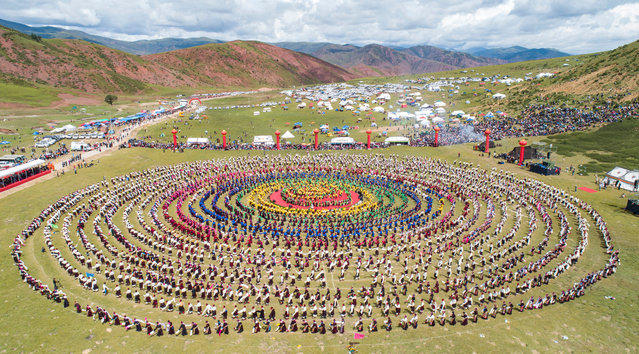 Aerial photo shows people performing Xianzi Dance in Mangkam County, southwest China's Tibet Autonomous Region, August 7, 2020. Xianzi Dance, a traditional folk dance in Tibet, was listed as a national intangible heritage in 2006. (Photo by Xinhua News Agency/Rex Features/Shutterstock)