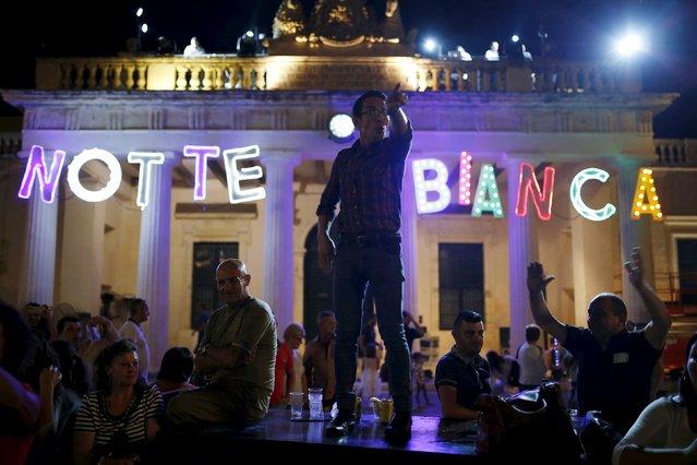 A reveller dances on a platform during Notte Bianca (White Night) celebrations in Valletta, Malta, October 3, 2015. (Photo by Darrin Zammit Lupi/Reuters)