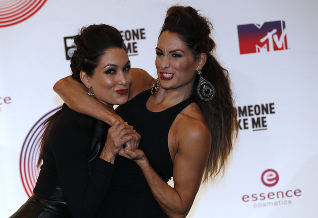 Singers The Bella Twins pose after performing during the 2014 MTV Europe Music Awards at the SSE Hydro Arena in Glasgow. (Photo by Russell Cheyne/Reuters)