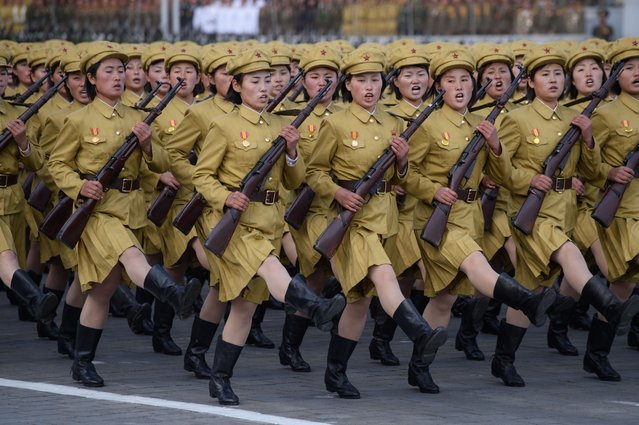 North Korean soldiers march during a mass military parade at Kim Il-Sung square in Pyongyang on October 10, 2015. (Photo by Ed Jones/AFP Photo)