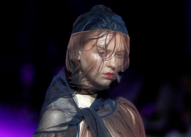 A model presents a creation by Ukrainian designer Ivan Frolov during Ukrainian Fashion Week in Kyiv, Ukraine on August 31, 2020. (Photo by Gleb Garanich/Reuters)
