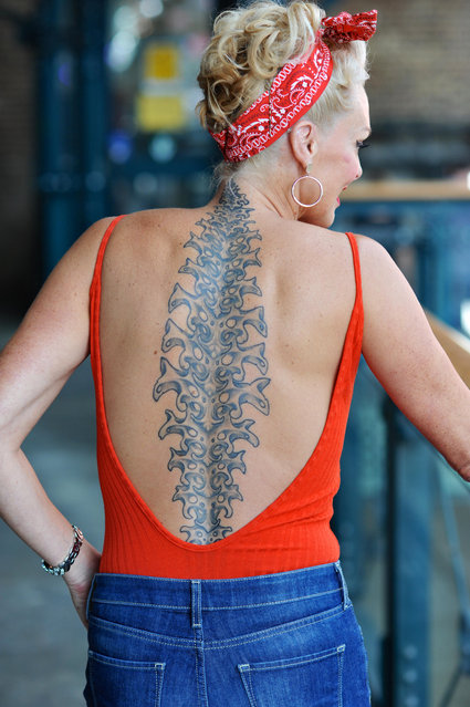 A tattooed woman at the opening day of the 12th London International Tattoo Convention, which opened today in Tobacco Dock, east London on September 23, 2016. (Photo by Michael Preston/Alamy Live News)