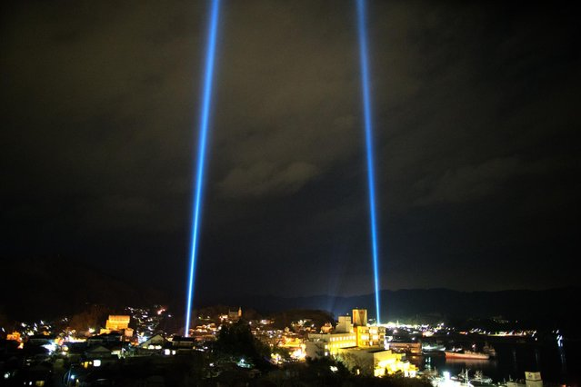 Kesennuma city is seen during a lightshow on March 11, 2013 in Kesennuma, Japan. Japan is commemorating the second anniversary of the 2011 Magnitude 9.0 earthquake and subsequent tsunami that claimed more than 18,000 lives. (Photo by Athit Perawongmetha)