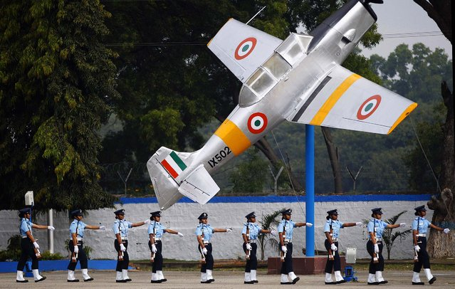 New graduates of the Indian Air Force participate in their passing out parade ceremony in Bangalore, India, Friday, November 28, 2014. A total of 121 officers including 45 women passed out Friday after 74 weeks of training at the primary force of the Indian Armed Forces. (Photo by Aijaz Rahi/AP Photo)