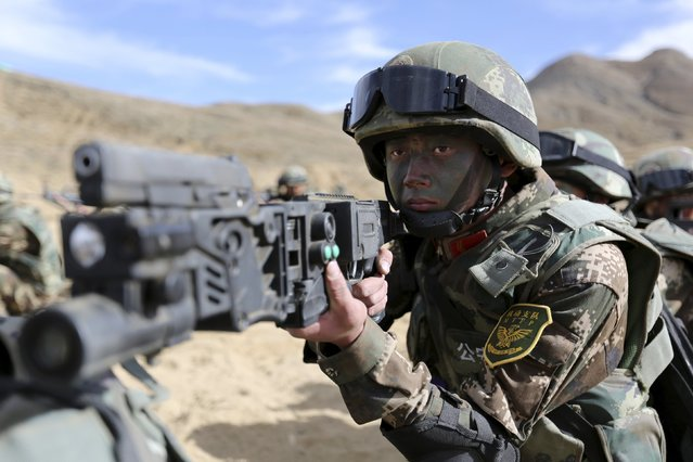 An armed policeman from Tibet border security force attends a drill at a military base in Shigatse, Tibet Autonomous Region, China, October 24, 2015. (Photo by Reuters/Stringer)