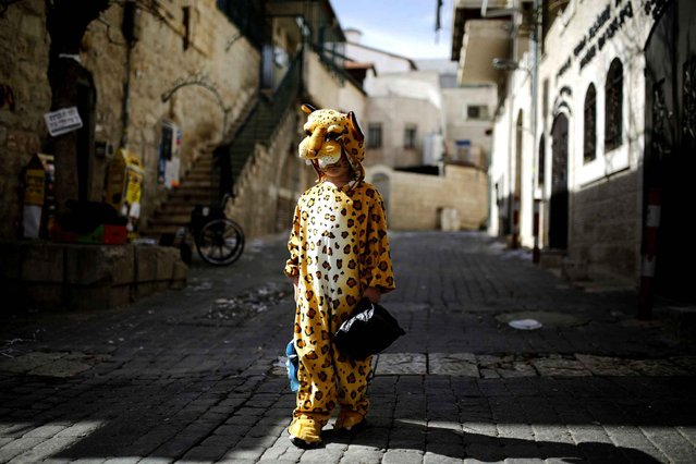 An ultra-orthodox Jewish boy wears a costume ahead of the Jewish holiday of Purim in Jerusalem's Mea Shearim neighborhood, on February 22, 2013. (Photo by Amir Cohen/Reuters /The Atlantic)