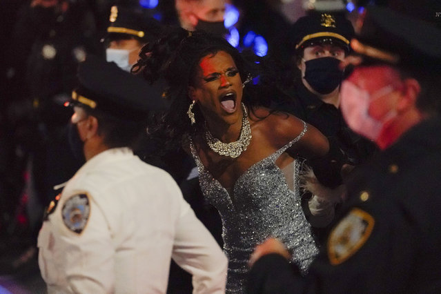 "New York Police officers arrest a drag queen during a weekly ""We Choose Freedom"" march through the West Village, Thursday, November 5, 2020, in New York. (Photo by Seth Wenig/AP Photo)"