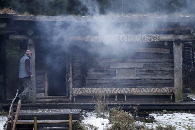Smoke rises as Urmas Veeroja heats up the smoke sauna at Mooska farm, near the village of Haanja December 20, 2014. (Photo by Ints Kalnins/Reuters)
