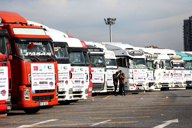 """A view of the articulated lorries ready to carry humanitarian aid boxes to transmit to Syria within the scope of the """"Goodness Our Route, Human Our Load"""", campaign, initiated by The Foundation for Human Rights and Freedoms and Humanitarian Relief (IHH) for Syrians, as part of the Human Rights Day from the Open Car Parking Lot of Ataturk Olympic Stadium in Istanbul, Turkey on December 10, 2020. (Photo by Ahmet Bolat/Anadolu Agency via Getty Images)"""