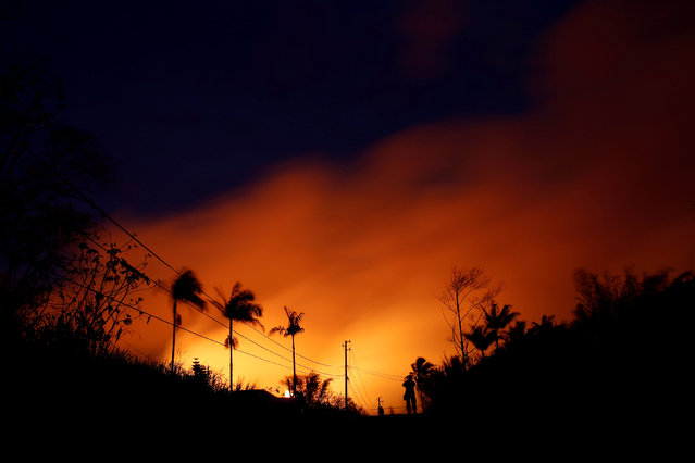 The night sky is illuminated by lava pouring from a fissure eruption of the Kilauea Volcano in the Leilani Estates near Pahoa, Hawaii, U.S., May 23, 2018. (Photo by Marco Garcia/Reuters)