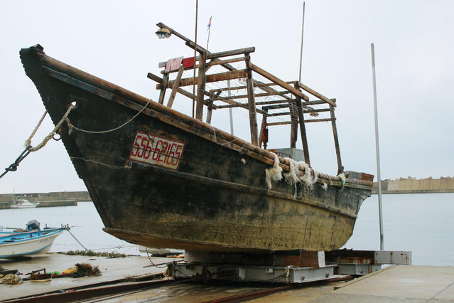 This November 29, 2015 photo shows a ship of unknown nationality in Wajima, Ishikawa prefecture, central Japan, after it was found in mid-November off Noto peninsula and was towed to the shore.  Japanese authorities are investigating nearly a dozen wooden boats carrying decomposing bodies found drifting off the northwestern coast over the past month. Coast Guard officials said Tuesday, Dec. 1, 2015. (Photo by Kyodo News via AP Photo)